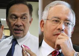Anwar (L) and incumbent Najib - Between the Devil and the not so Angelic.