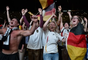 German fans celebrate as Germany wins the FIFA World Cup 2014 final football match Germany vs Argentina played in Brazil during an outdoor viewing at the Olympic stadium in Munich, southern Germany on July 13, 2014. Germany won 1-0. AFP PHOTO/CHRISTOF STACHECHRISTOF STACHE/AFP/Getty Images