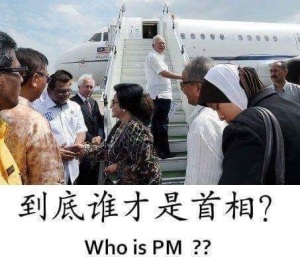 Najib on the jet's staircase is waiting for the PM Rosmah  to finish shaking hands with the officials (source: unknown)